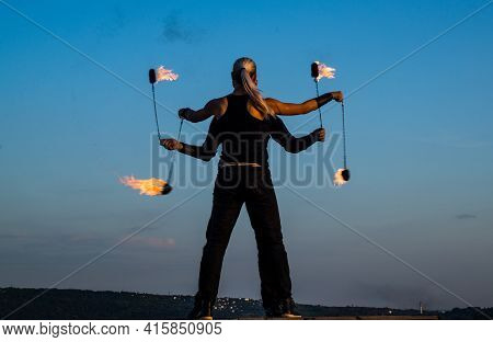 Sensual Couple Of Dancers Perform Fire Performance With Burning Poi Blue Sky Outdoors, Hot