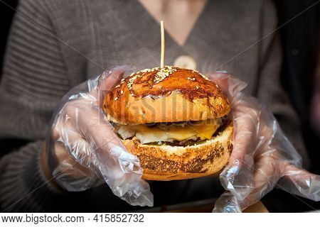 Girl Holding A Hamburger In Her Hands And Getting Ready To Eat It. Close-up, Selective Focus