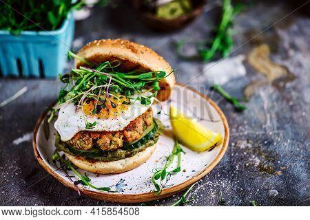 Fish Burger With Avocado Sauce .selective Focus