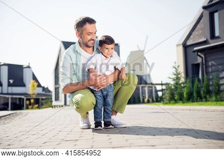Portrait Of Two Nice Cheerful People Daddy Embracing Youth Son Walking Street Sunny Day Having Fun I