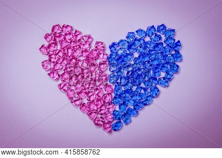 Heart Shape Made Of Pink And Blue Crystals Or Gemstones On Bright Background. Heterosexual Relations