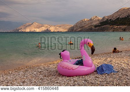 Baska, Croatia - July, 23: View Of A Swimming Inflatable Ring With Flamingo Design On The Beach On J