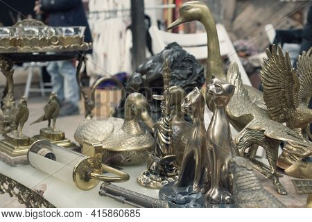 Antiques On Flea Market Or Festival - Vintage Silver And Cooper Statuettes And Other Vintage Things.