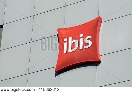 Lugano, Ticino, Switzerland - 16th March 2021 : Ibis Hotels Sign Hanging On The Hotel Building In Pa