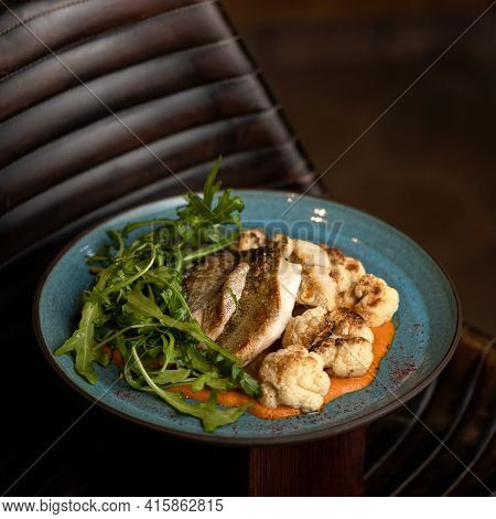 Hearty Omega-3 Diet Lunch. Fried River Fish With Vegetables. Food Plate On Black Background. Cooked