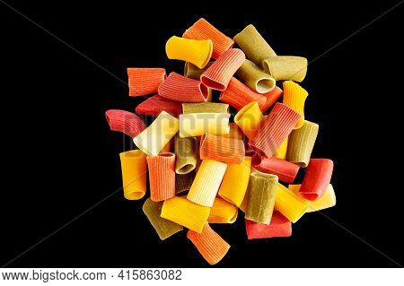 Assorted Multicolored Ones In Rigatoni. Grocery Food Background, Isolated On A Black Background. Top