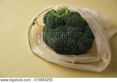 Fresh Broccoli In A Reusable Fabric Eco Bag. Reusable Eco-friendly Products.