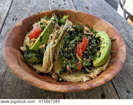 Surf Tacos - Kale Salad With Veggie Mix Tossed In Ginger Tahini Dressing. Served On Warm Pita With G
