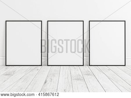 Triple 8x10 Vertical Black Frame Mockup On White Wooden Floor And White Wooden Wall. Three Empty Pos