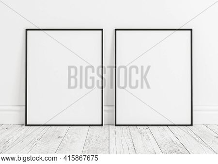 Double 8x10 Vertical Black Frame Mockup On White Wooden Floor And White Wooden Wall. Two Empty Poste