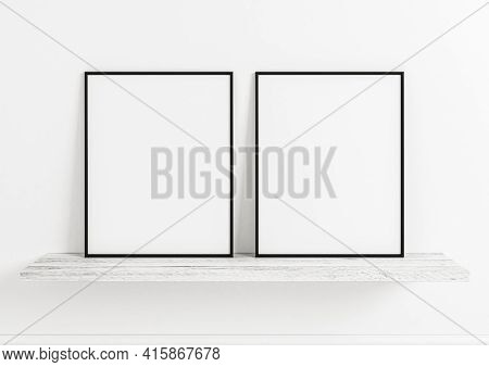 Double 8x10 Vertical Black Frame Mockup On Wooden Shelf And White Wooden Wall. Two Empty Poster Fram