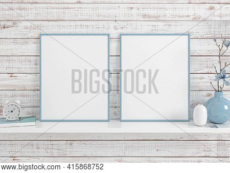 Double 8x10 Vertical Blue Frame Mockup On White Shelf And White Wooden Wall. Two Empty Poster Frame