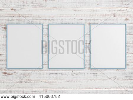 Triple 8x10 Vertical Blue Frame Mockup On White Wooden Wall. Three Empty Poster Frame Mockup On Whit