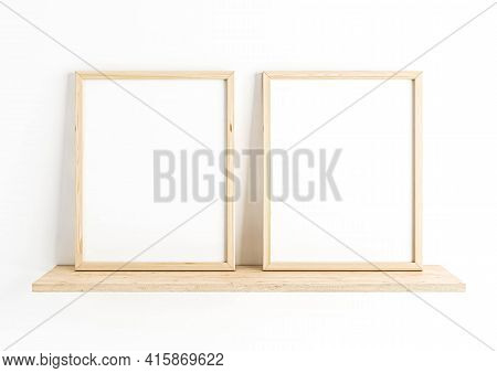 Double 8x10 Vertical Wooden Frame Mockup On Wooden Shelf And White Wall. Two Empty Poster Frame Mock