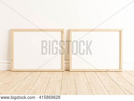 Double 8x10 Horizontal Wooden Frame Mockup On Wooden Floor And White Wall. Two Empty Poster Frame Mo