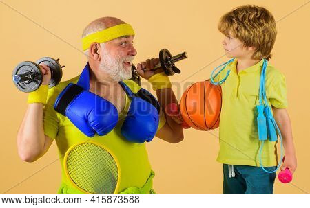 Family Time Together. Healthy Grandfather And Grandson Workout. Grandfather And Kid Sporting.