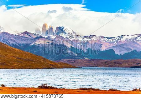 Lagoon Azul is an amazing mountain lake near three rocks - torres. The mountain range is covered with eternal snow. The famous Torres del Paine park in southern Chile.