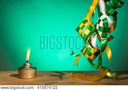 Conceptual Traditional Malay Oil Lamp Named Pelita With Decorative Ketupat For Hari Raya Aidilfitri