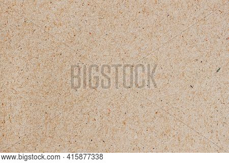 Texture Of Old Ecological Paper, Background, Copy Space. Recyclable Material With Colorful Inclusion
