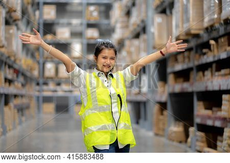 Shot Of Cheerful Positive Warehouse Workers In Storage Department. Happy People While Taking A Break