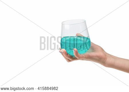 A Woman's Hand With An Exotic Cocktail Isolated On A White Background. An Exotic Drink.