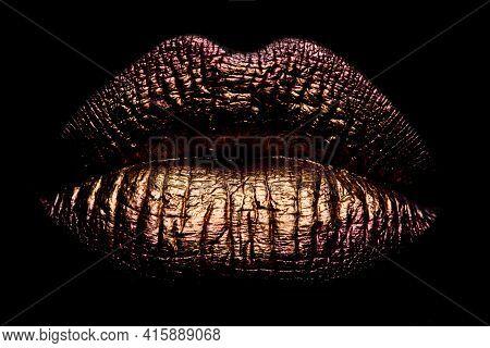 Abstract Gold Lips. Golden Lips Closeup. Gold Metal Lip. Beautiful Makeup. Golden Lip Gloss On Beaut