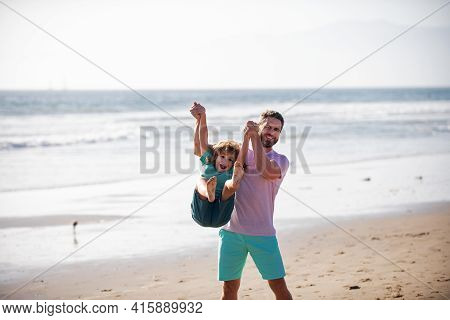 Dad And Child Playing Outdoor. Dad And Child Enjoy Spring Day