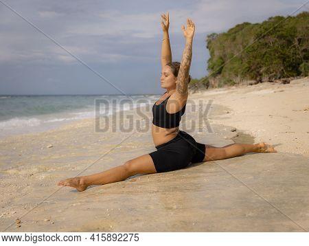 Yoga Practice. Attractive Caucasian Woman Practicing Hanumanasana, Monkey Pose Or Front Split. Arms