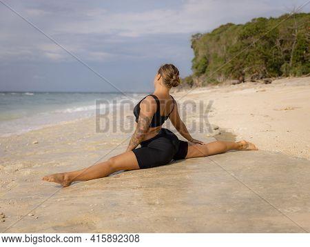 Yoga Practice. Attractive Caucasian Woman Practicing Hanumanasana, Monkey Pose Or Front Split. Hamst