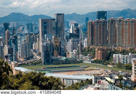 Hong Kong - 22 JUNE 2006: Hong Kong Skyline with Racetrack in foreground