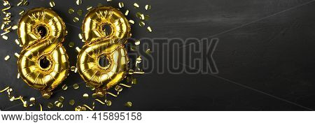 Golden Foil Balloon Number Eighty Eight. Birthday Or Anniversary Card With The Inscription 88. Black