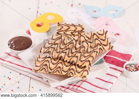 Carnival Pastry With Chocolate On White Dish.