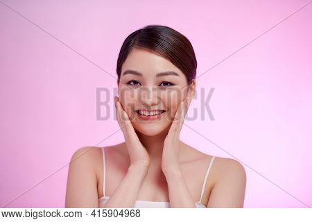 Spa Beauty. Young Model Woman Touching Her Hand Her Face. Healthy Skin, Facial Treatment And Cosmeto