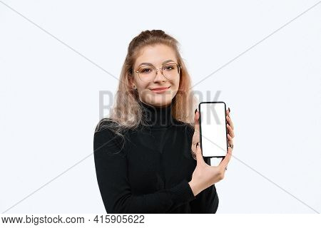 Note That. Smiling Young Woman Showing Empty Smartphone Screen To Show Advertisement, Standing Again