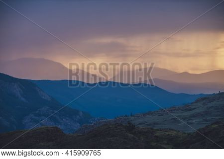 Atmospheric Landscape With Silhouettes Of Mountains With Trees On Background Of Vivid Orange Blue Li