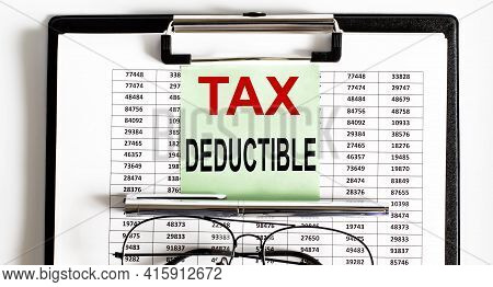 Closeup Of The Deadline Time Tax Deductible And Glasses And Pen
