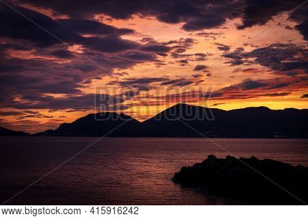 Beautiful Sunset In The Gulf Of La Spezia View From The Small Village Of Tellaro. On The Left The Fa
