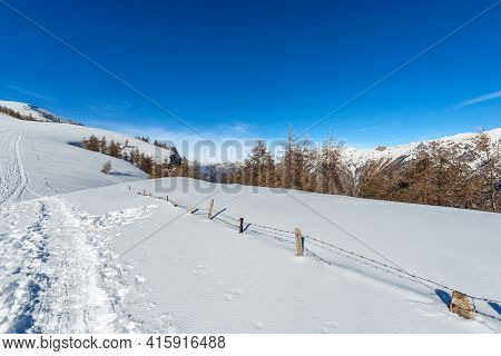 Landscape Of Lessinia High Plateau In Winter With Snow, On Background The Mountain Range Of The Bren