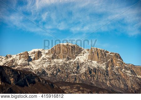 Snowcapped Mountain Range Of The Paganella In Winter With The Roda Peak (2125 M) With The Antennas O