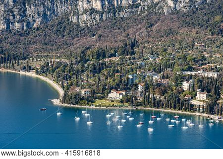 Aerial View Of The Small Garda Town, Tourist Resort On The Coast Of Homonymous Lake Garda, View From