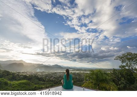 Rurrenabaque, Bolivia, January 7: Woman Sitting And Meditating In Front Of An Aerial Panoramic View