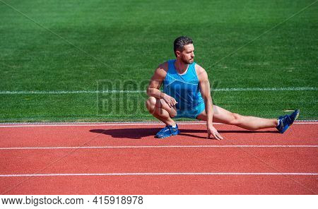 Mature Man Stretching His Legs Before A Stadium Workout, Stretch
