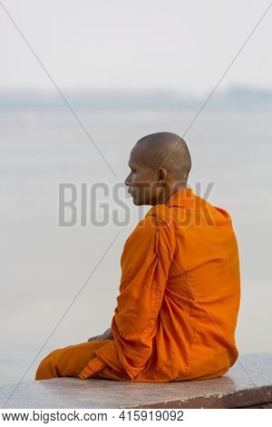 Phnom Penh, Cambodia - January 27: Young Cambodian Monk Sitting By The River The Mekong In Phnom Pen