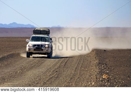 Puros, Namibia, January 10: 4x4 Prepared Off-road Car Driving In The Kaokoland Desert With Blue Sky