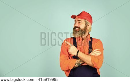 Mad Repairman Concept. Man Wear Boilersuit. Bearded Worker In Overalls. Confident Mature Mechanic. P