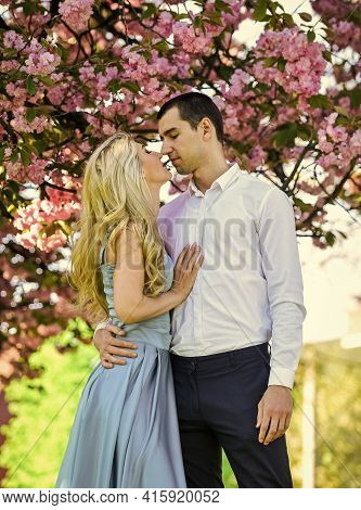 Love Story. Loving People Hug. Passion Concept. Man And Woman In Blooming Garden. Couple Spend Time