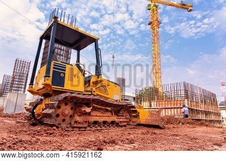 Excavator For Working With Earth And Sand In Sandpit In Foundation Work Of The Building At Construct
