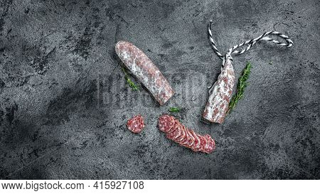 Fuet Catalan Dry Cured Sausage Cut In Slices. Traditional Spanish Fuet Thin Dried Sausage. Banner, M
