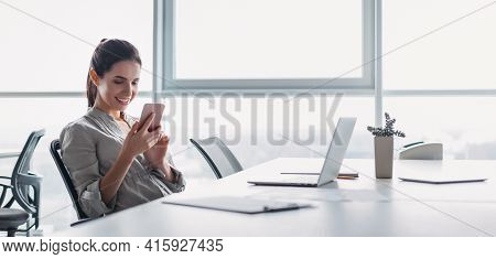 Website Header Of Young Business Woman On The Phone At Office. Business Woman Texting On The Phone.