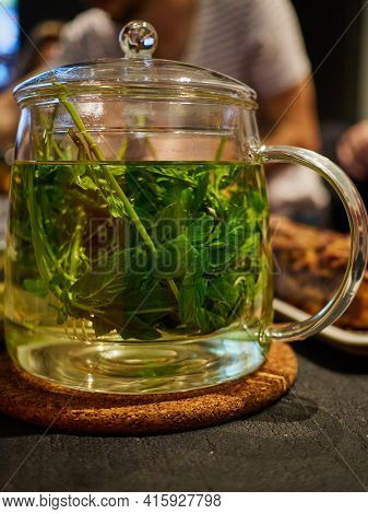 Freshly Made Chinese Style Hot Mint Green Tea Served In A Clear Galss Pot